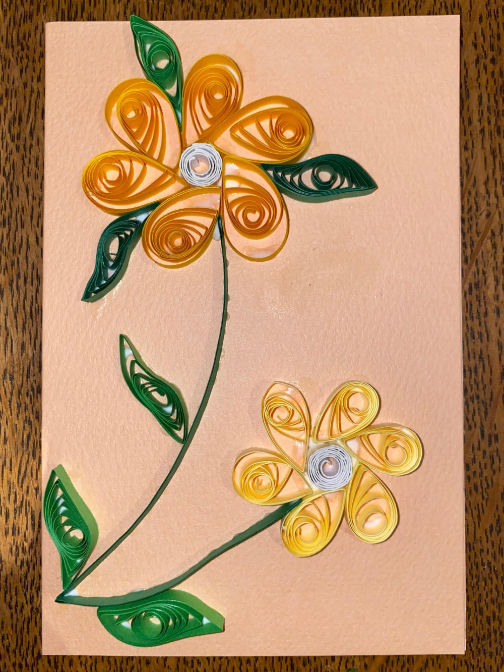 Flowery greetings card made by quilling paper
