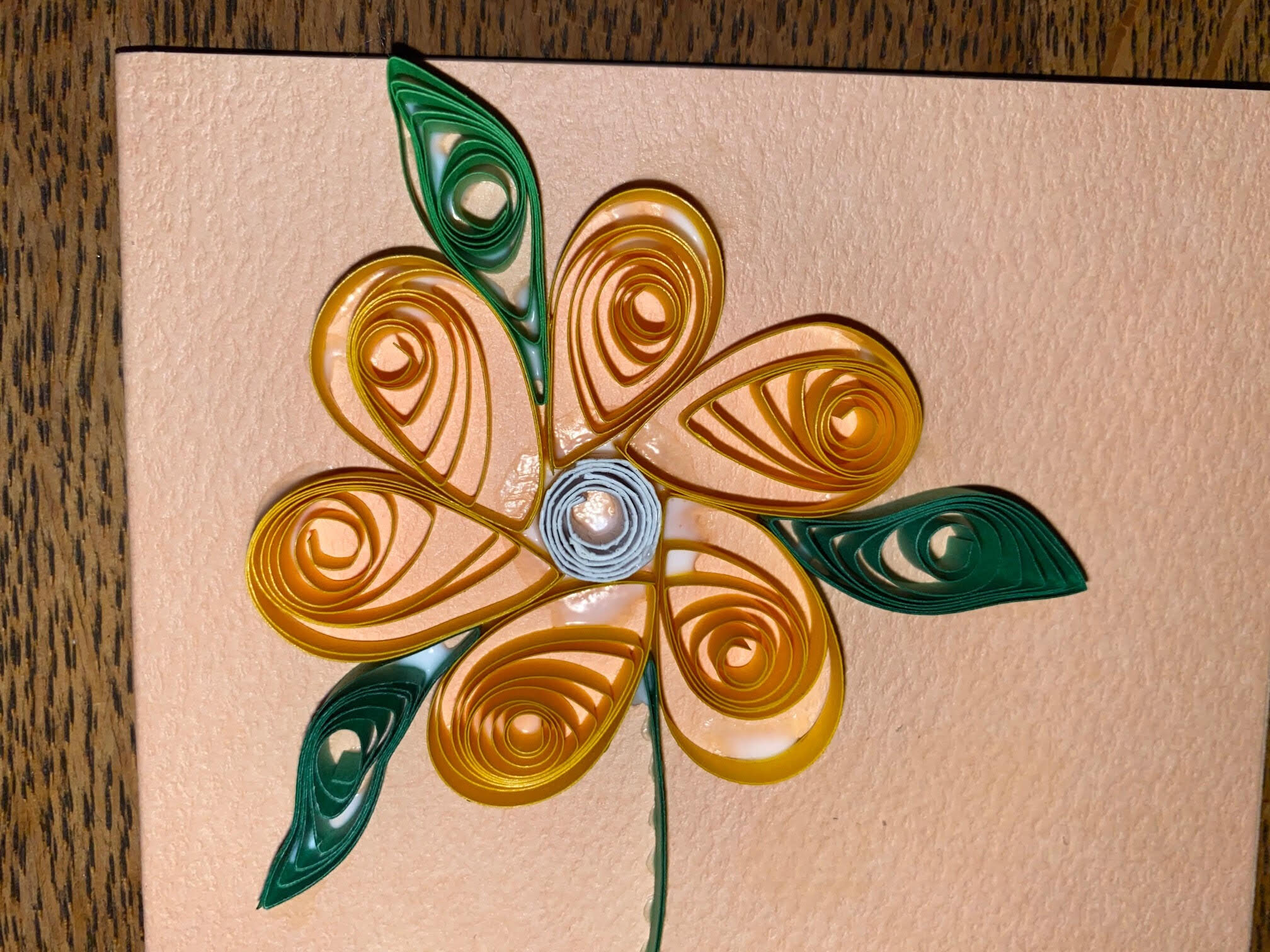 Close-up of Flowery greetings card made by quilling paper