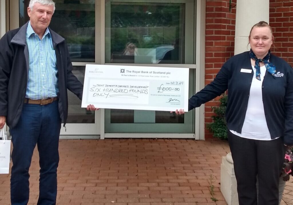 Cheque presentation to Tom Dening, Trent Dementia Services Development Centre from Lisa Moore, Deputy Home Manager, Barchester Hall Park Care Home